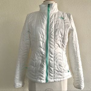 The North Face white and teal puffy jacket
